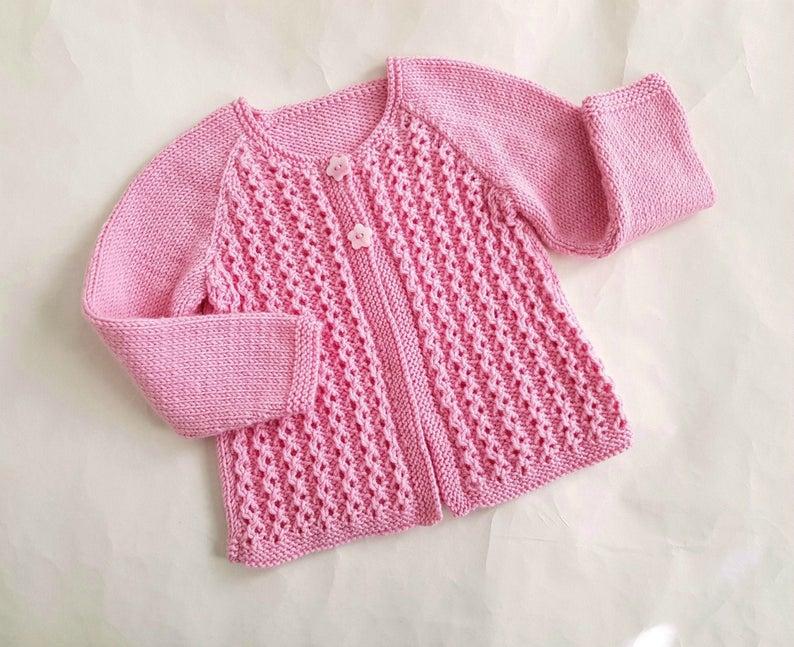 Handknitted light pink wool cardigan
