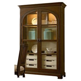 "Featuring 2 glass doors and a tobacco finish, this versatile wood display cabinet adds farmhouse-inspired style to your decor. 3 lighted shelves showcase your heirloom china, while 6 drawers stow linens, serveware, and tabletop accessories.    Product: Display cabinetConstruction Material: Cherry veneers, select hardwood solids and glassColor: TobaccoFeatures:  Part of the Paula Deen Home CollectionSix tray drawersAdjustable shelvesAccommodates:  Bulbs - not includedDimensions: 83"" H ..."