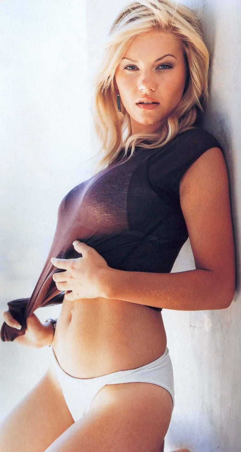Elisha Cuthbert: The covered-up top is just as good as the uncovered bottom. (But let's hurry up and uncover that busty top anyway!) ;-) ♥♥