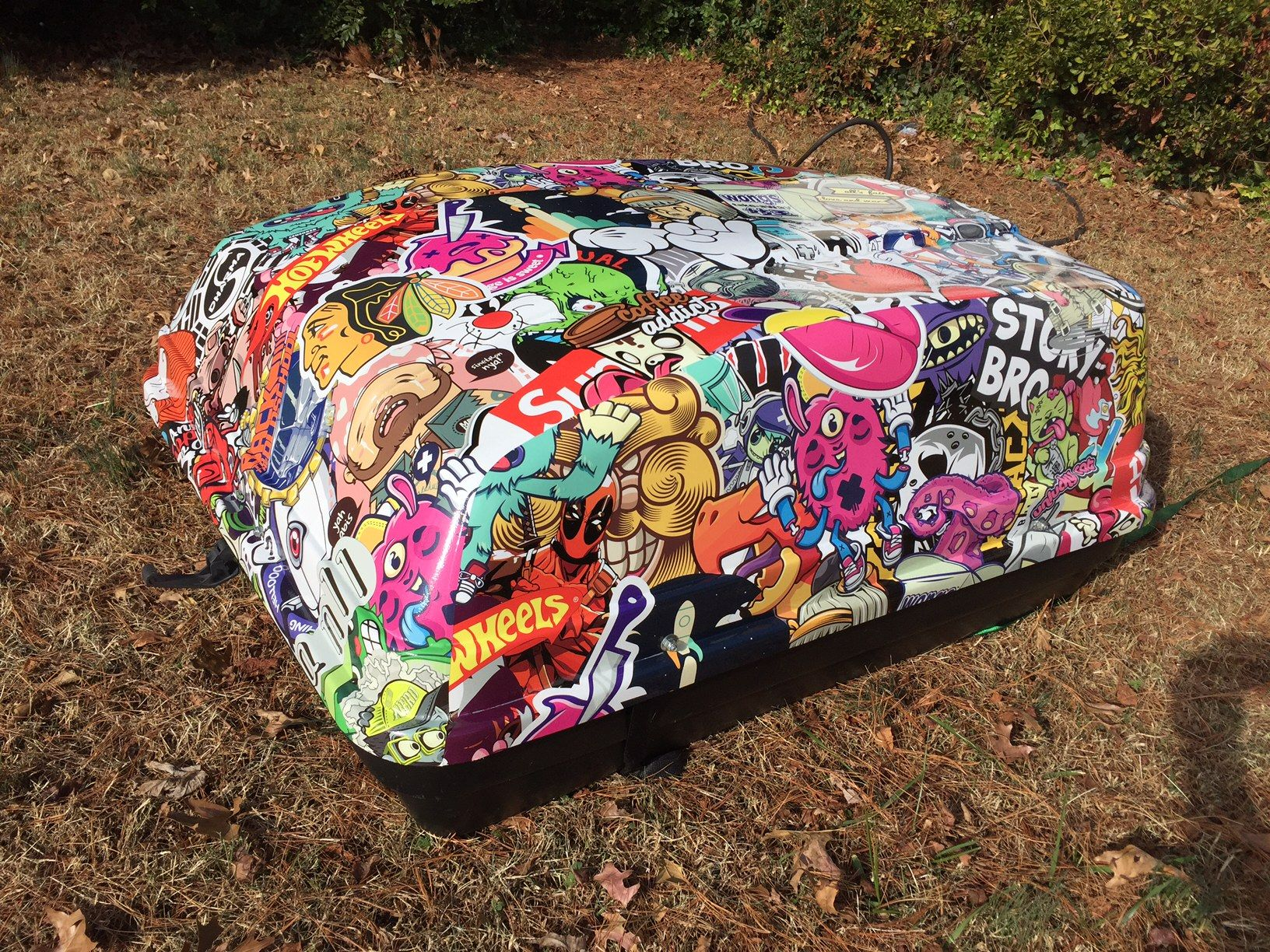 Custom sticker bomb car top luggage carrier wrap installed by six eight creative richmond va