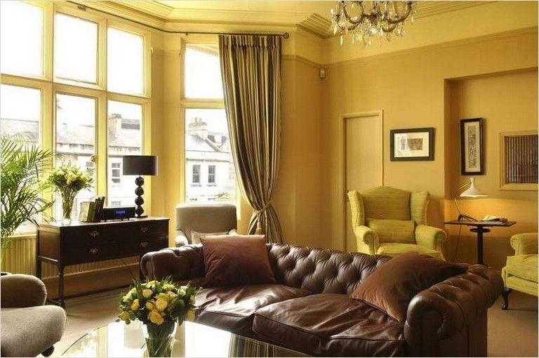 yellow walls living room brown living room