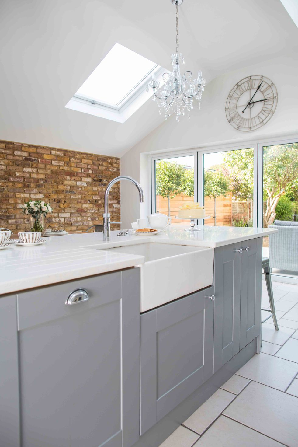 Small galley kitchen transformed into spacious room for the entire family to socialise #greykitcheninterior