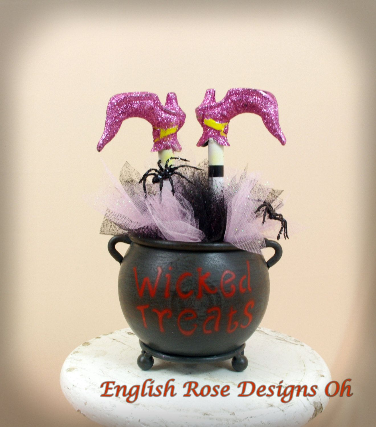 upside down wicked witch of the east in a cauldron witches cauldron witch boot halloween centerpieceshalloween decorationshalloween - Halloween Centerpieces