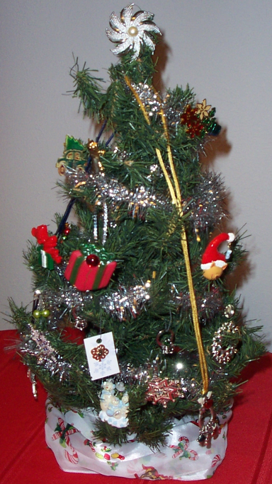 Christmas Tree Bling DIY - how to create a Decorative Holiday Jewelry Stand using a Tabletop Christmas Tree - see video link and step-by-step instruction at http://org-this.blogspot.com/2011/11/create-decorative-jewelry-stand-using.html