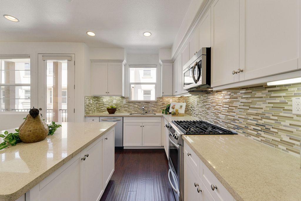 Contemporary Kitchen with Capri Limestone Quartz ...