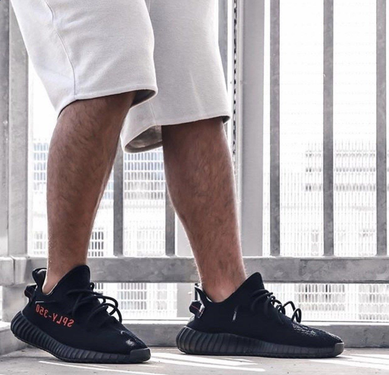 51b8c3423a5 Yeezy Boosts with shorts. Adidas Yeezy Boost 350 V2 Bred.