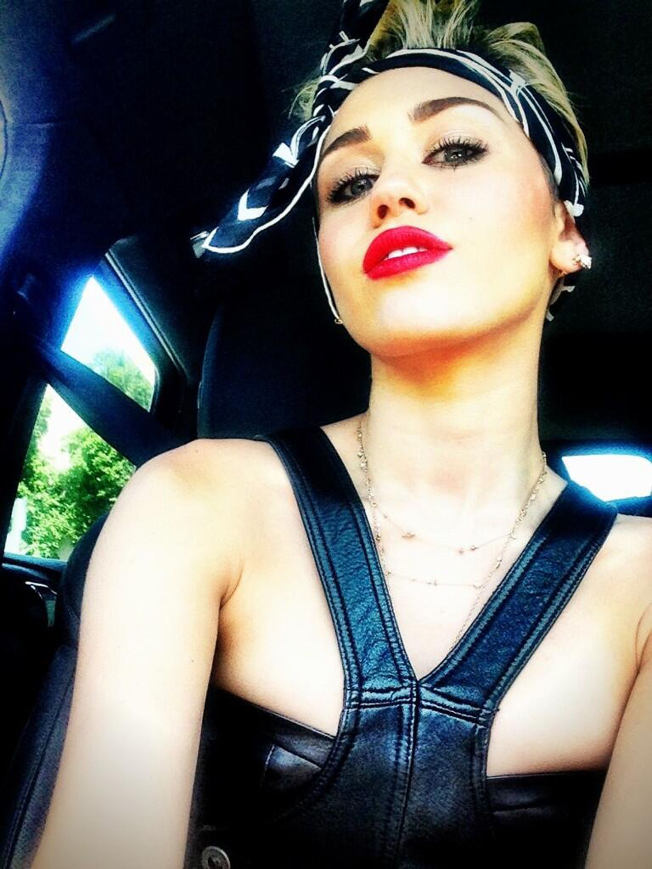 Miley in a bandana mileyus raunchiest photos ever celebs