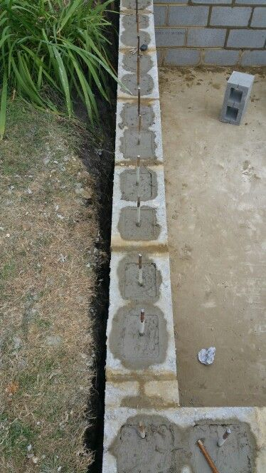 Concrete blocks with reinforced metal bars retaining for Cinder block pond