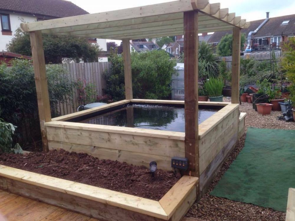 Railway sleeper pond pergola and raised beds got to try for Small pond construction