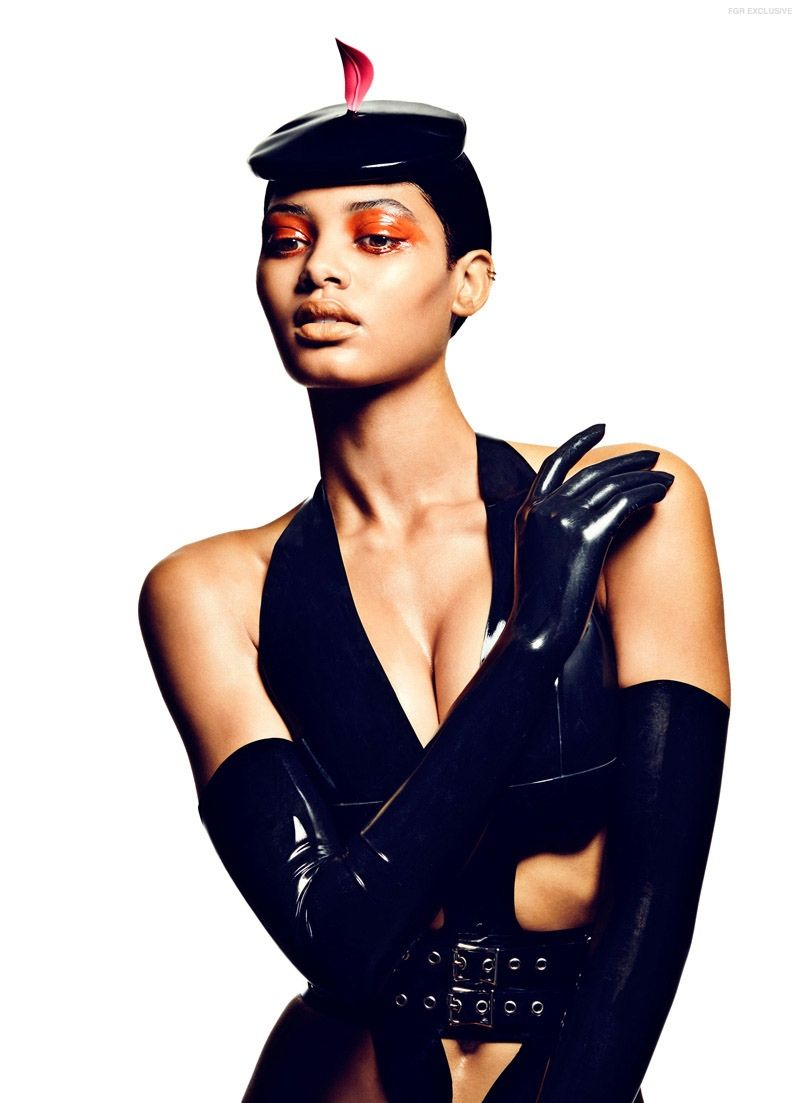 An all black look including gloves features a pop of orange and red.