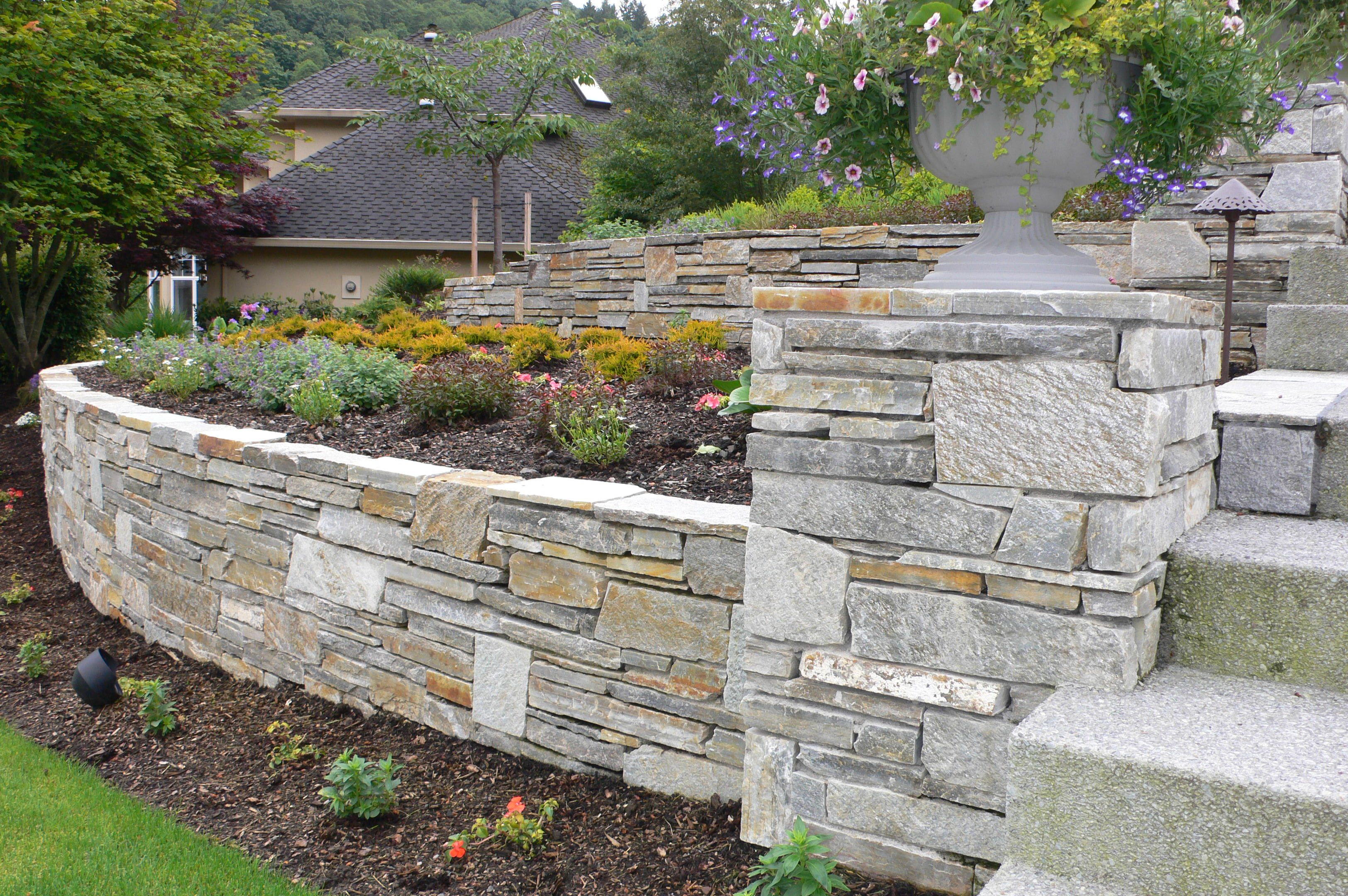 Mica ledgestone retaining wall by landscape east west for Landscape retaining wall design