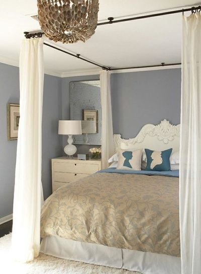 use ceiling mounted curtain rods to create a canopy over a regular bed