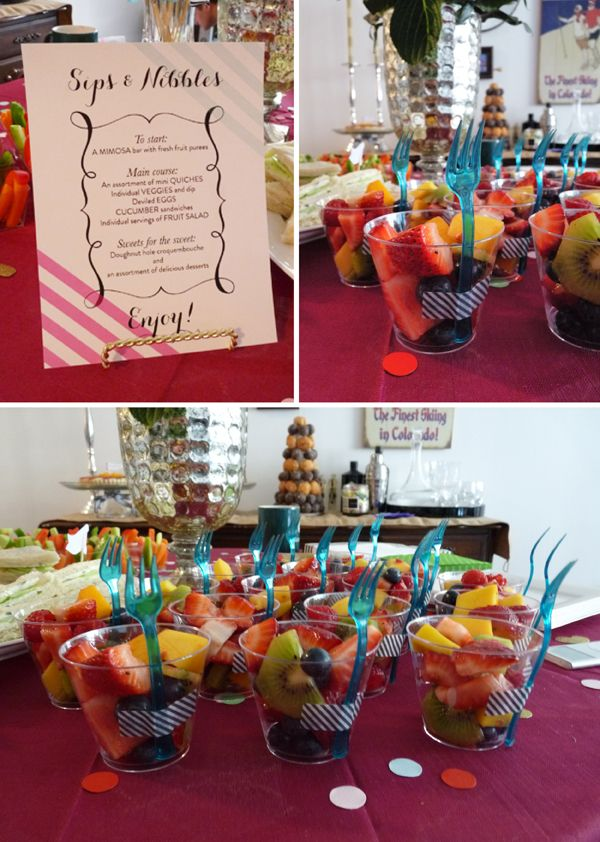 individual servings of fruit salad with washi tape-secured cocktail forks
