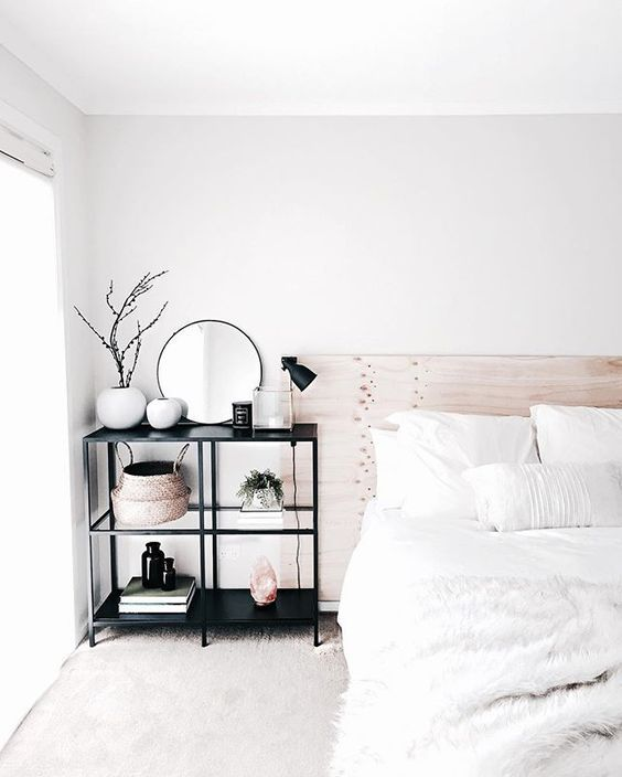 Modern Minimal Bedroom Design Featuring A Bleached Wood Headboard White Bedding Black Metal And Glass Shelves As A Bedside Table Home Bedroom Home Interior