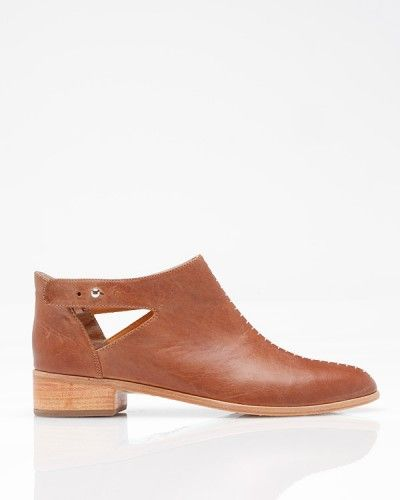 Albertina    Plomo Shoes    Low cut leather ankle booties from Plomo, featuring side cut outs with buckle detail, stitching accent down front, and low stacked wood heel.