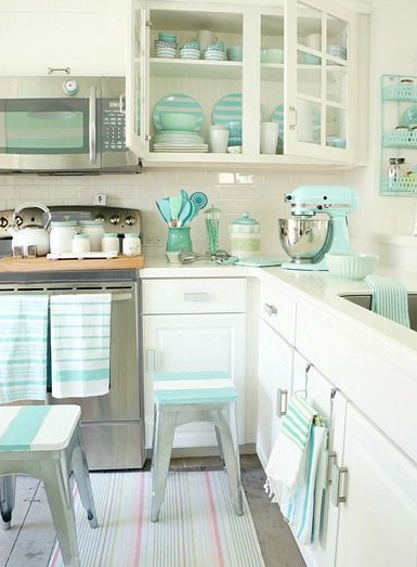 all the tiffany blue accents in this kitchen are so pretty. great