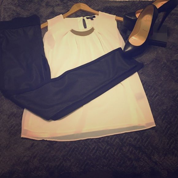 NWOT White sleeveless blouse Sleeveless blouse with gold metal detail at neckline. Size small, but would also fit a medium. If you wear a small it has a looser fit to it, so would look amazing with a pair of skinnies or leather leggings and heels. This is NWOT. Tops Blouses