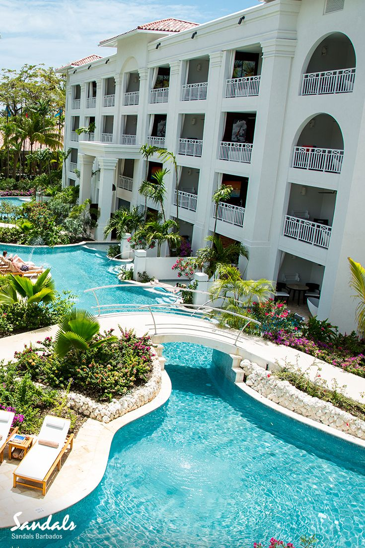 d9cd973fb34 Swim up suites along Barbados  longest lagoon pool at Sandals Barbados.