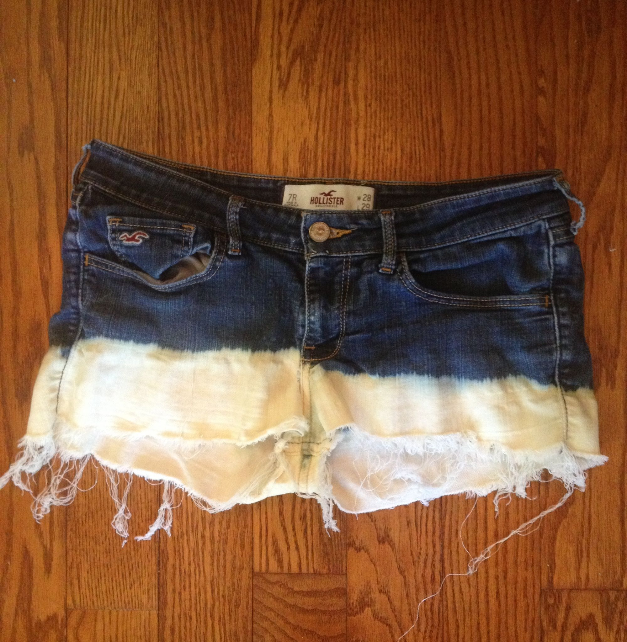 DIY dip dye shorts:  1. Find a old pair of jeans and cut them into shorts. 2. Get a bucket or tub and put bleach in it. 3. Dip the ends of the shorts into the bleach. 4. Let it dry then enjoy!