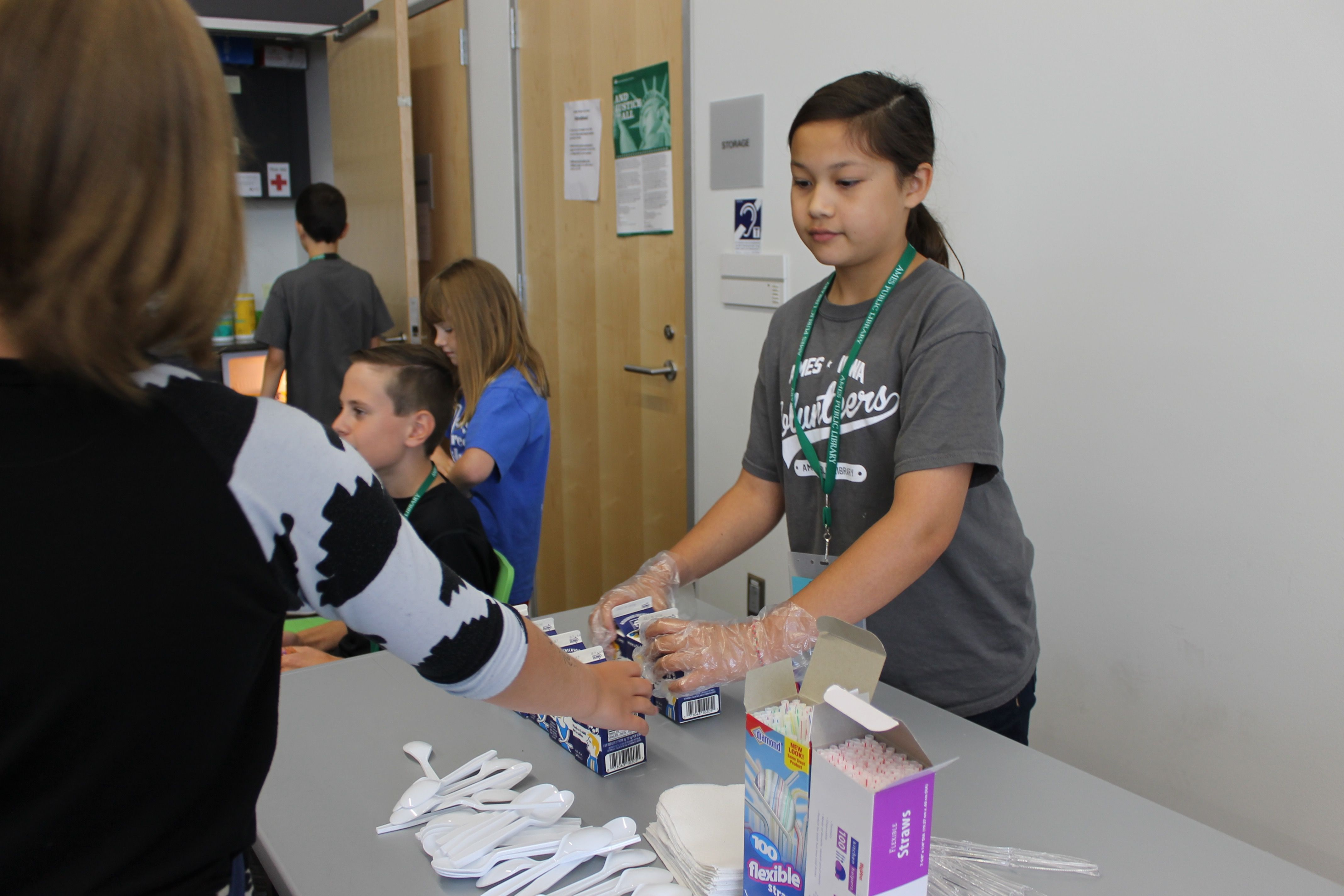 Ames Public Library Volunteer Emma Dorhout 13 Hands Out Cartons Of Milk For The Library S Summer Meals For Teens And Kids Programming For Kids Photo Tribune