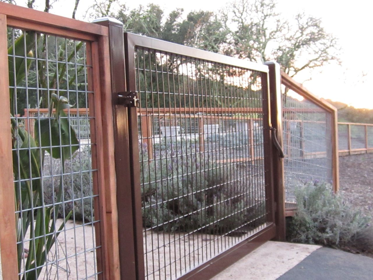 wire fence with a steel gate by arbor fence inc