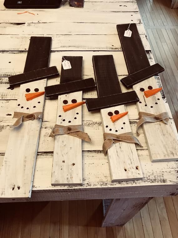 Handcrafted snowman on a pallet board Specify tall or short via email. Ships within 1 week