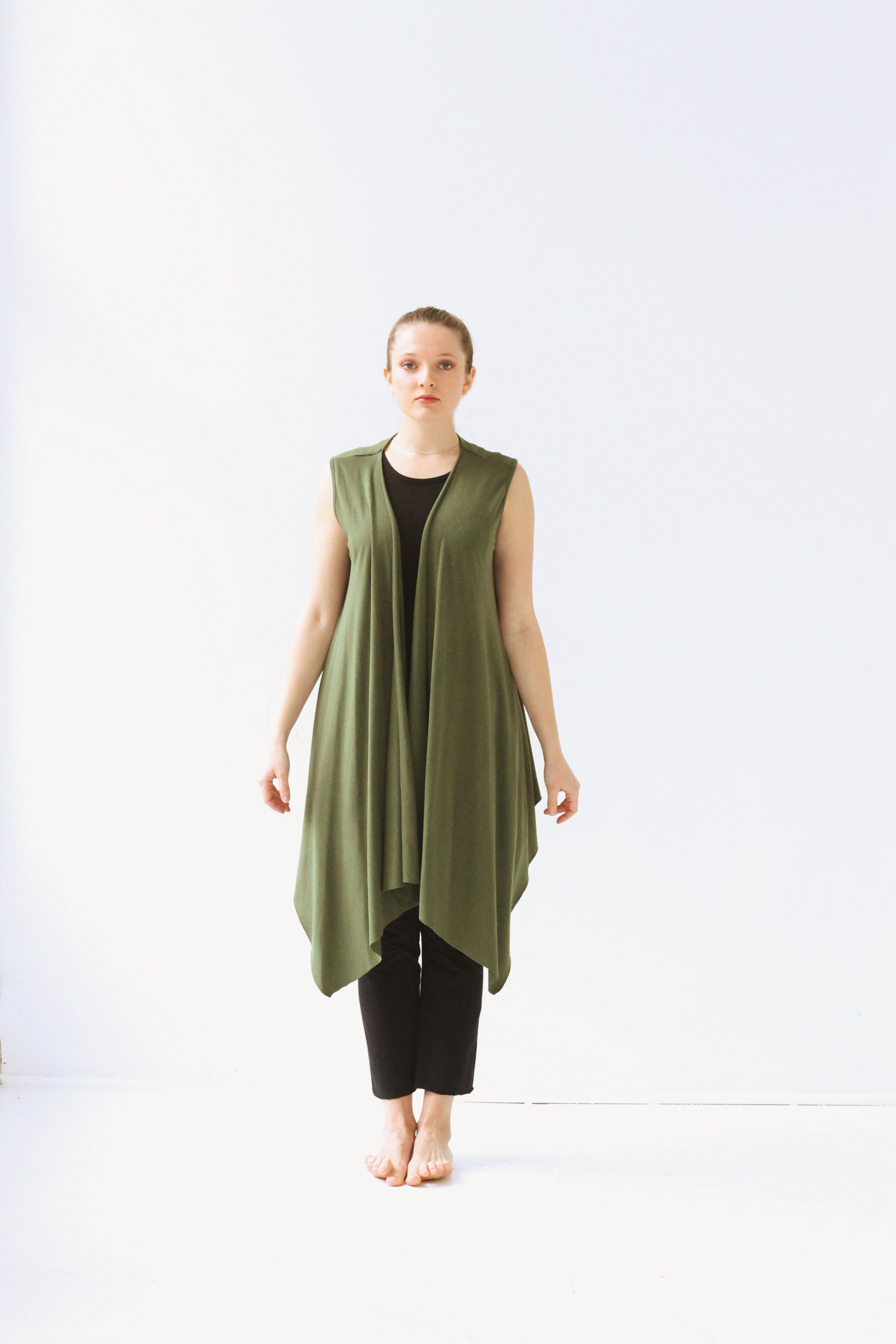 Green Long Waterfall Vest. This loose fitted vest is a great layering piece of shape and color. $79 Available at www.jqlovesu.com