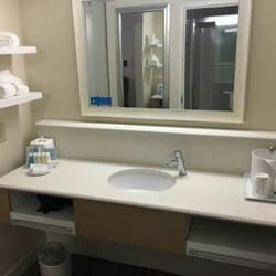 Hotel Vanity and Countertop Supplier Hampton Inn Wall Hung Bathroom w white stain towel shelf