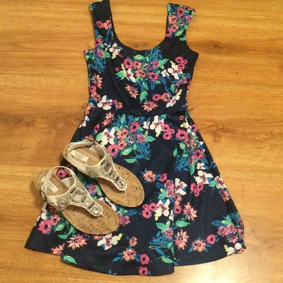 Candies Floral Print Dress Flowy and adorable! Such a beautiful floral pattern! It's a dark navy blue background with multi colored flowers that really pop! Never worn, brand spanking new! Message with questions! Candie's Dresses