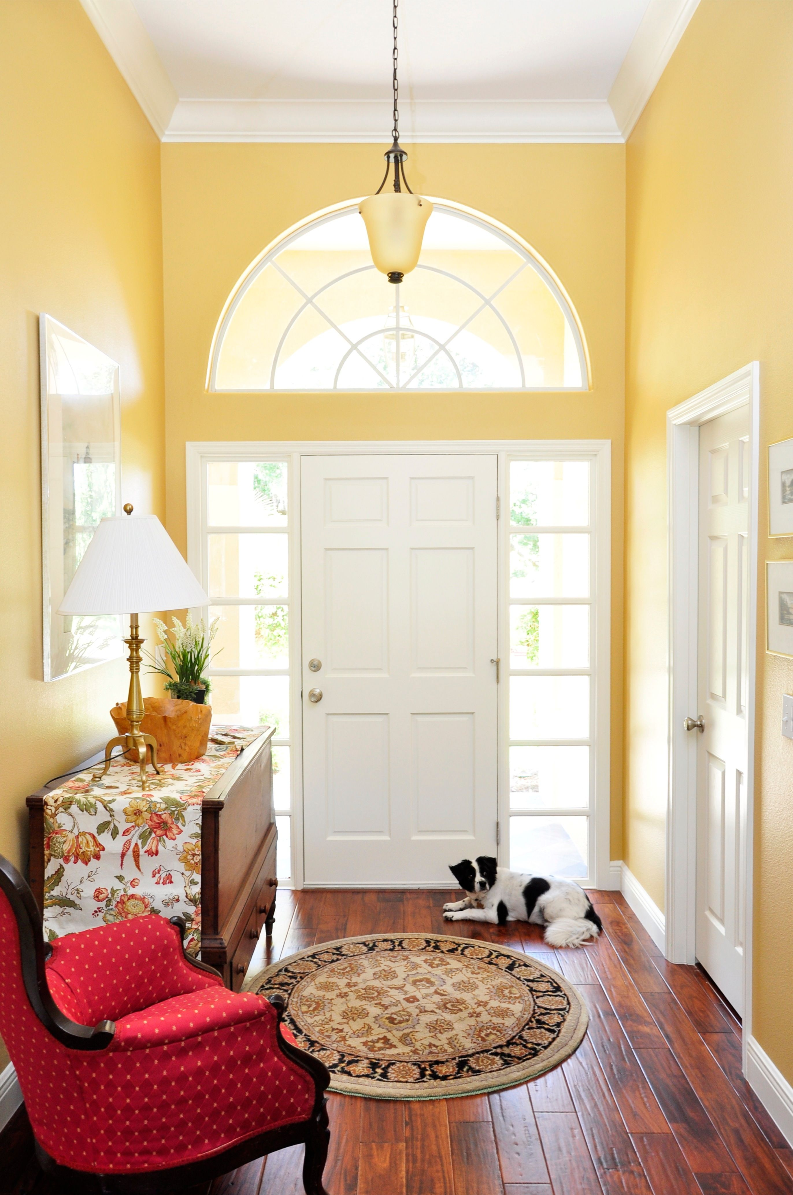 beautiful bright sunny lemon yellow foyer entrance with white front ...