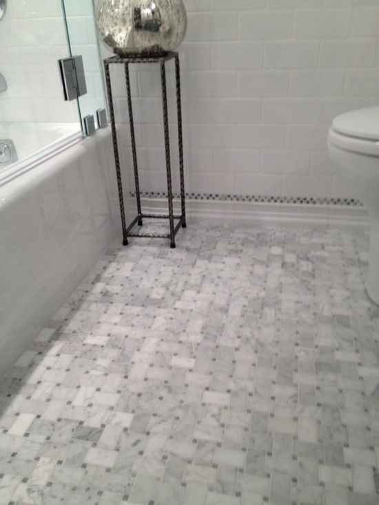 bathroom floor #bathroomdecoration #bathroom Stunning bathroom floor composed of marble basketweave tiles and subway tile baseboard. Guest bathroom with subway tile backsplash and drop-in tub with glass partition.