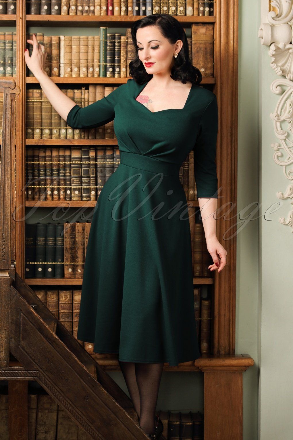 2aba1087db9d1 Feminine and flirty this 50s Ruby Swing Dress in Forest Green!Wow, such a  stunner! This vintage inspired beauty features an elegant diamond shaped  neckline, ...