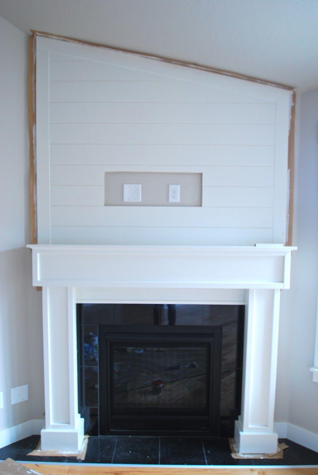 A SALTBOX: Shiplap paneling, fireplace surround ...