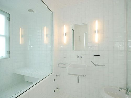White Sink and Clear Mirror on White Tile Floor - Key Home Design