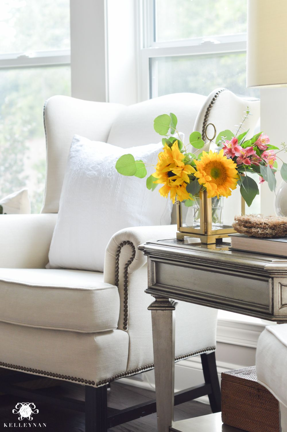 Merveilleux Floral Arrangement In Lantern  Living Room Flowers In Gold Pottery Barn  Lantern And Wingback Chair