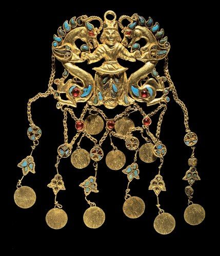 One of a pair of pendants showing the Dragon Master, Tillya Tepe, Tomb II. Second quarter of the 1st century AD.  Gold, turquoise, garnet, lapis lazuli, carnelian and pearls.  National Museum of Afghanistan