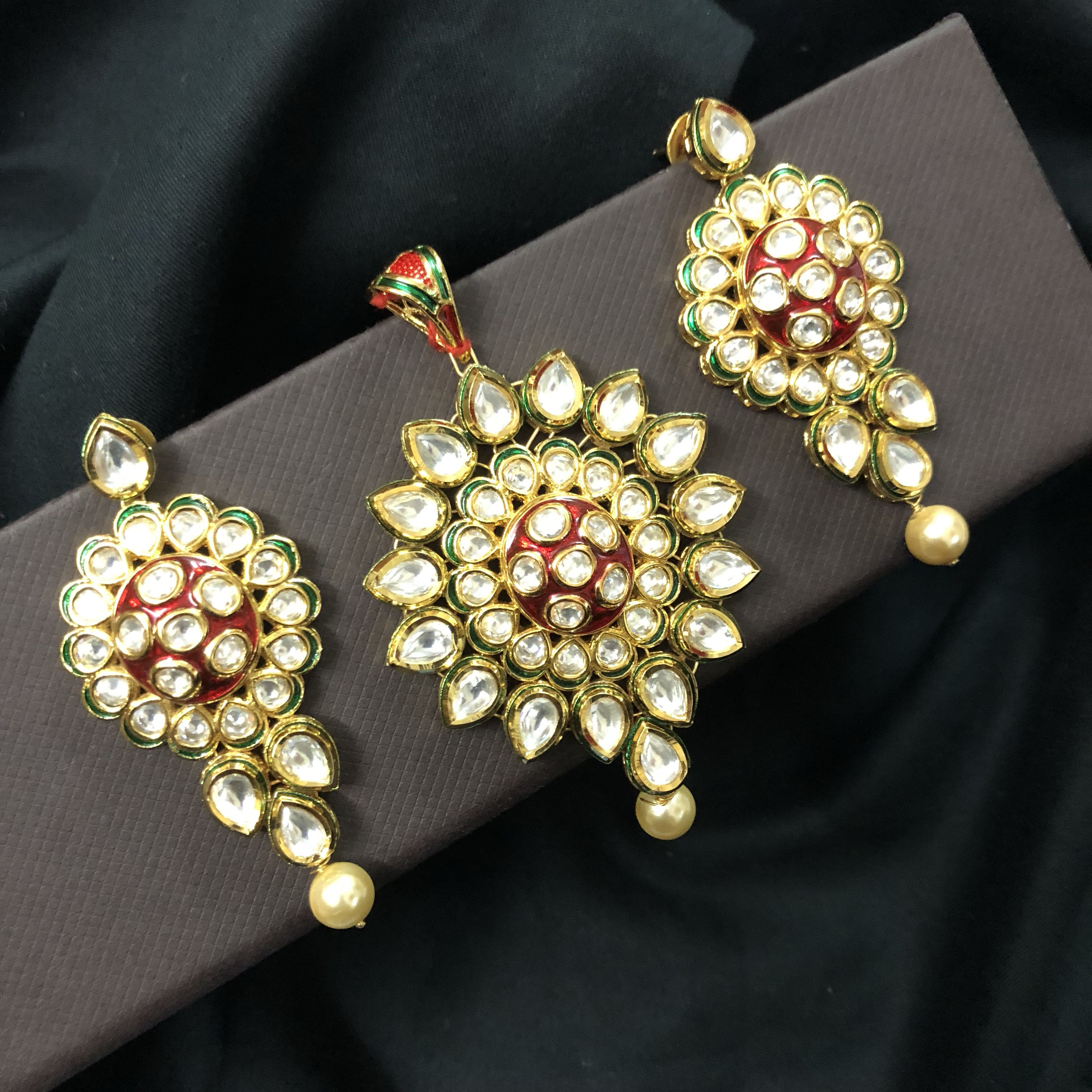 Red meenakari centrepiece fully engaged with kundan and south pearl