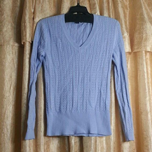 Tommy Hilfiger Blue Sweater Never worn light blue sweater A little wrinked but in excellent condition Tommy Hilfiger Sweaters V-Necks