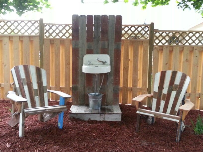 Adirondack chairs and fountain from repurposed fencing