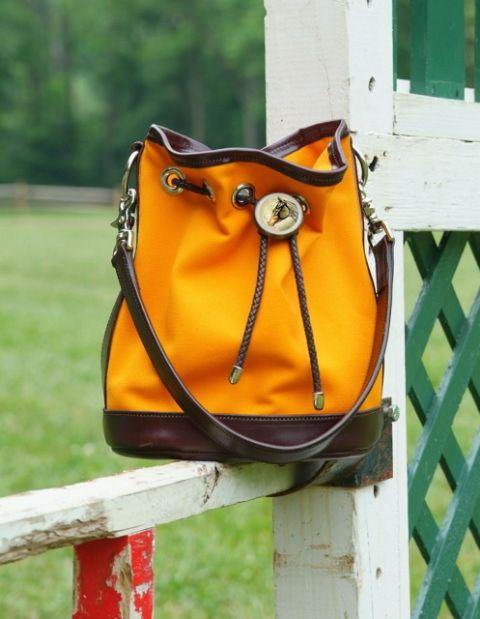 The Molly Handbag available in Natural, Orange, Red and Tan.  www.bainbridgeandcompany.com