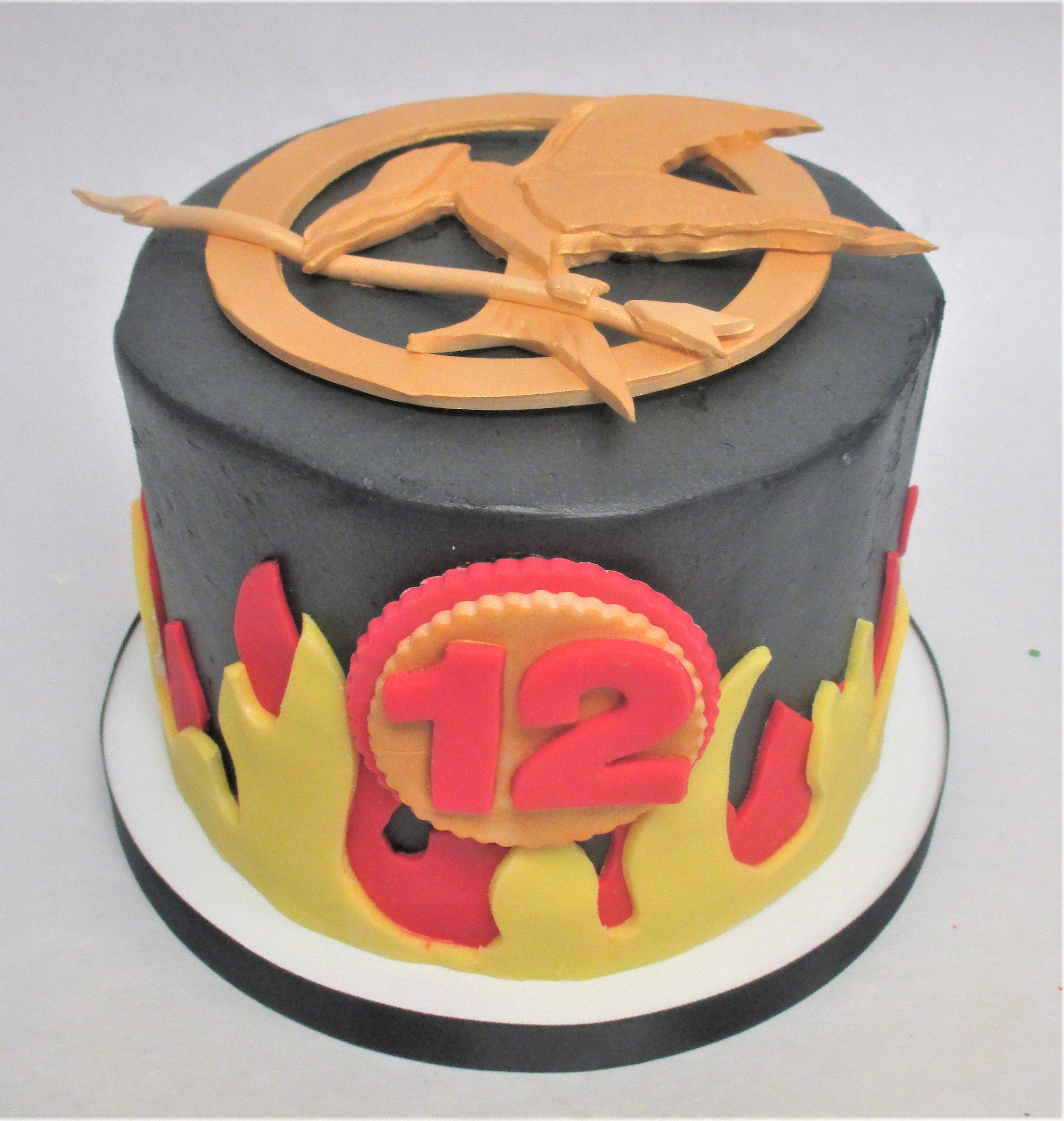 Hunger Games Mockingjay Inspired Birthday Cake by Flavor Cupcakery