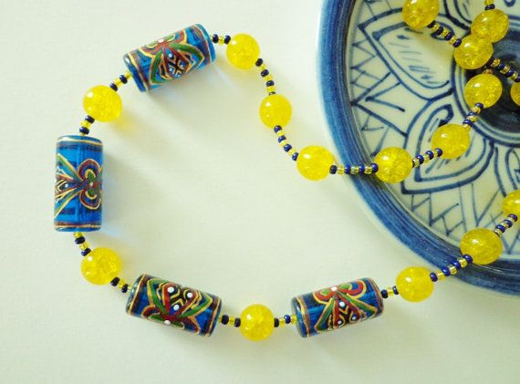 Hey, I found this really awesome Etsy listing at https://www.etsy.com/listing/123196552/lemony-yellow-and-royal-blue-glass-bead