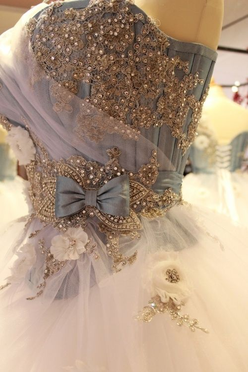 A Cinderella-like ball gown with blue corset covered in beaded embroidery.
