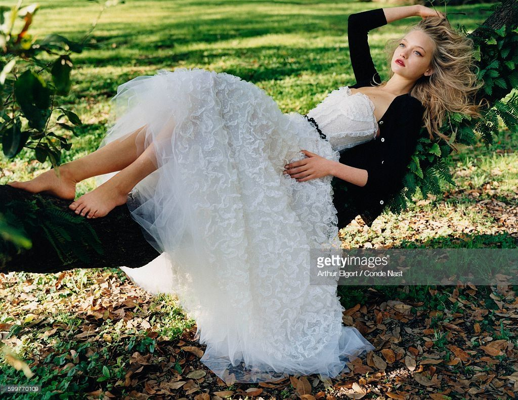Model Gemma Ward reclines on a low hanging tree limb wearing a Oscar ...