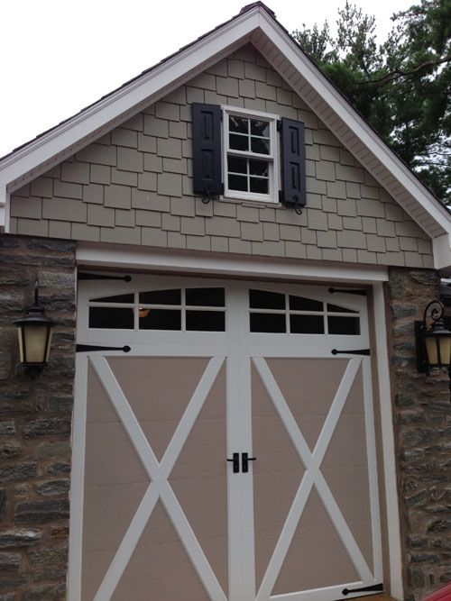 Timberlane Shutters on the Garage add the final touch to the home's makeover.