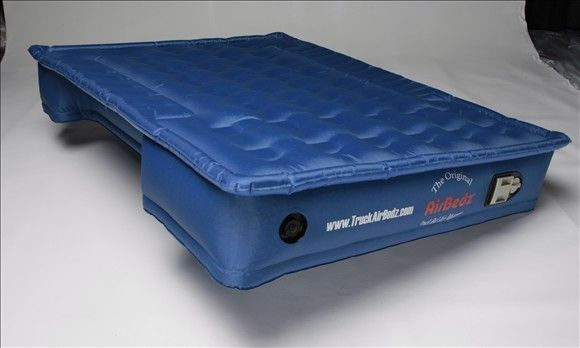 Truck bed air mattress. Cut outs for the wheel wells. #Genius.