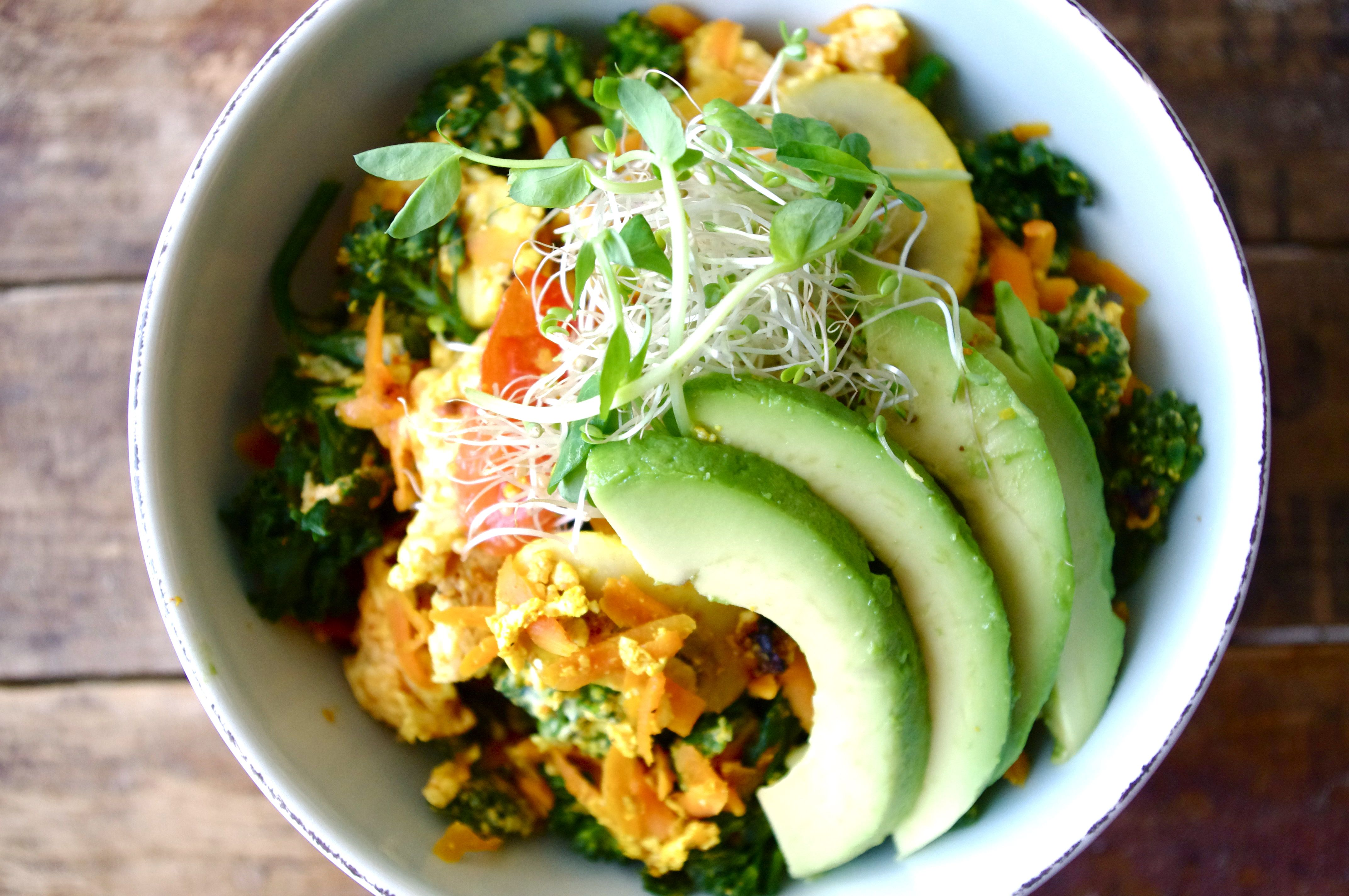 """The original """"Zen"""" dish was served on a plate with the egg scramble, a side of brown rice, and a side of black beans, topped with avocado and sprouts."""