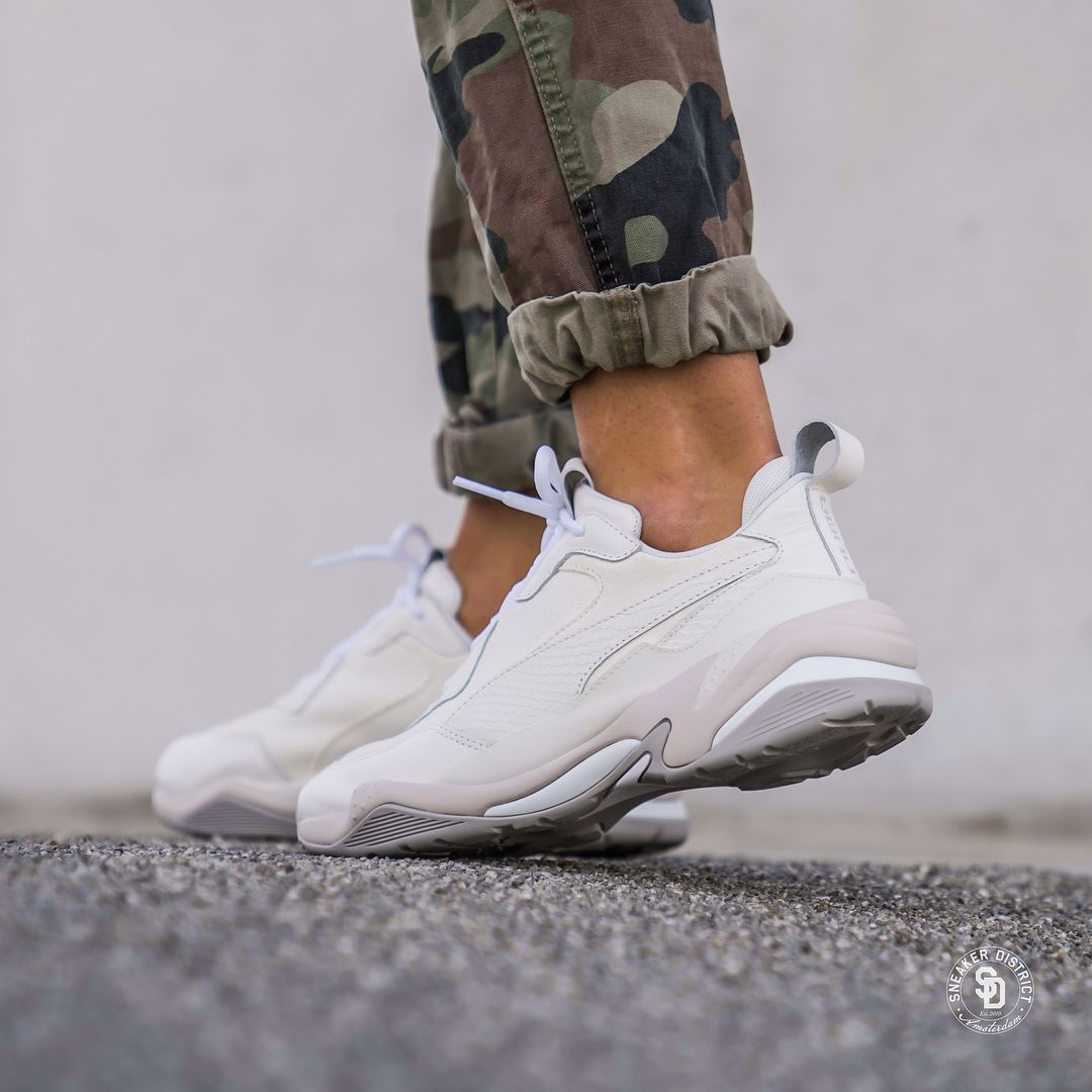 Puma Thunder Desert White/Violet available online now.