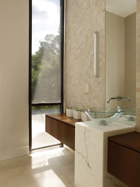 designed long bathrooms. bath This powder room plays on modern style geometry with a unique custom  vanity designed by Michael Habachy The entire wall features linear wood shelf Love the long skinny window Helps to bring outside in and unify