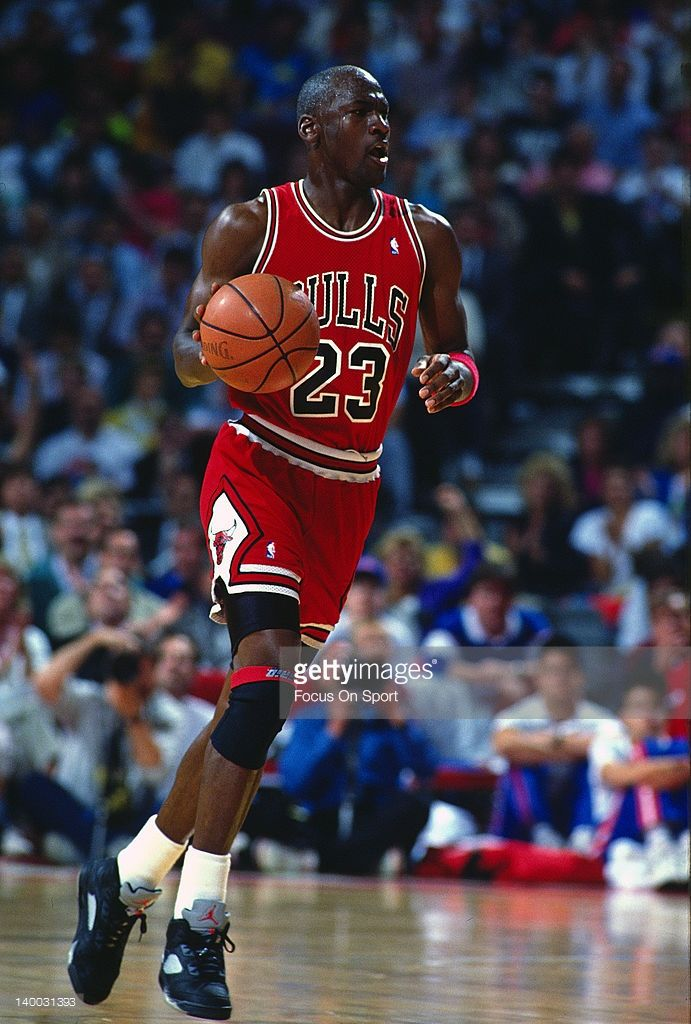 Michael Jordan  23 of the Chicago Bulls dribbles the ball up court against  the Washington Bullets during an NBA basketball game circa 1990 at the  Capital ... 6961b1c42c539